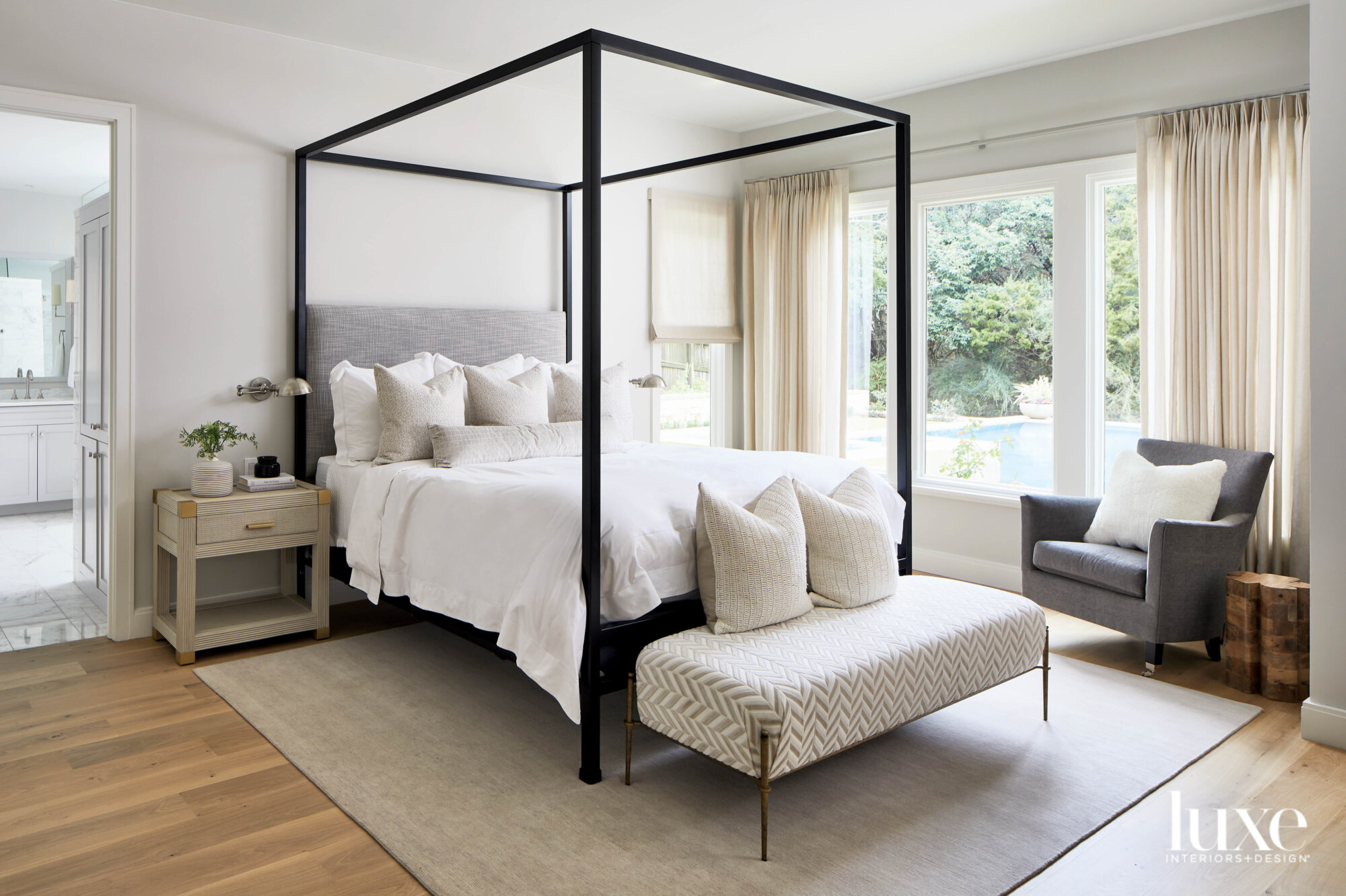 Neutral bedroom with bold four...