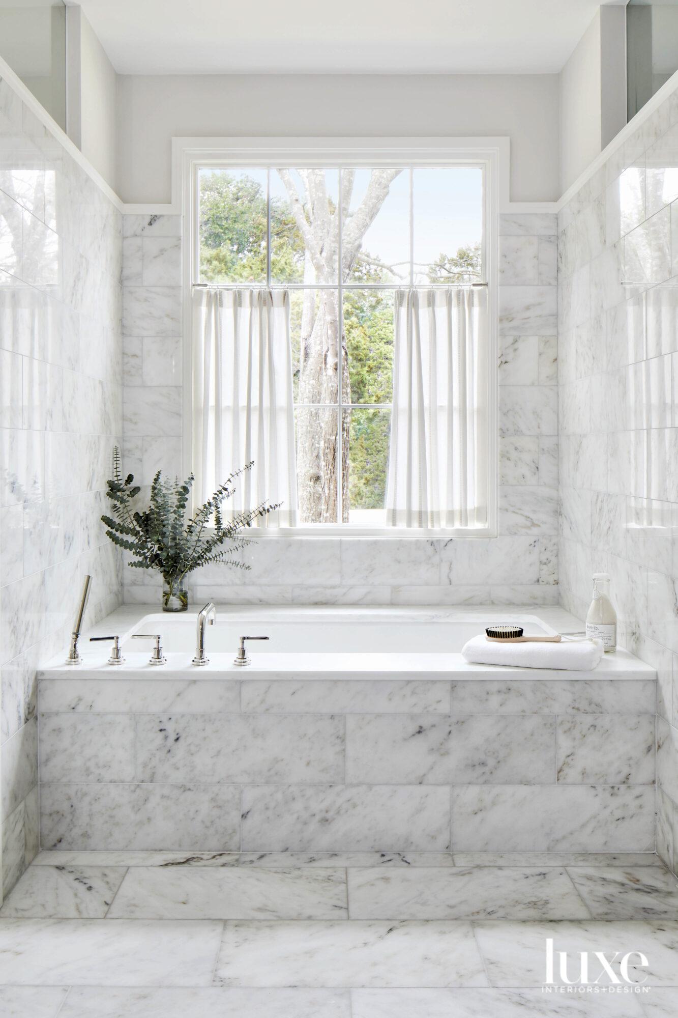 Marble-clad tub area.