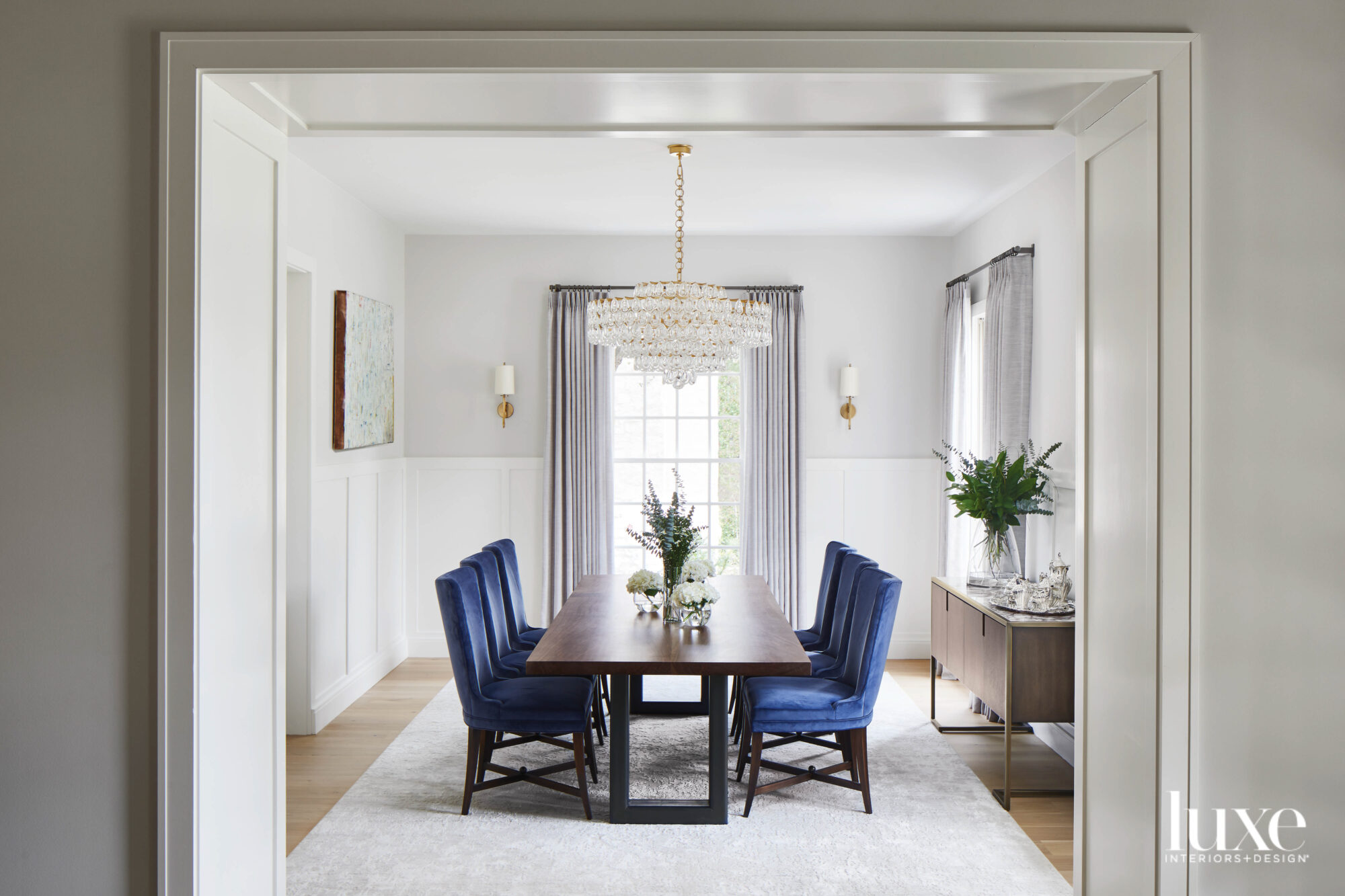 Neutral dining room with blue...