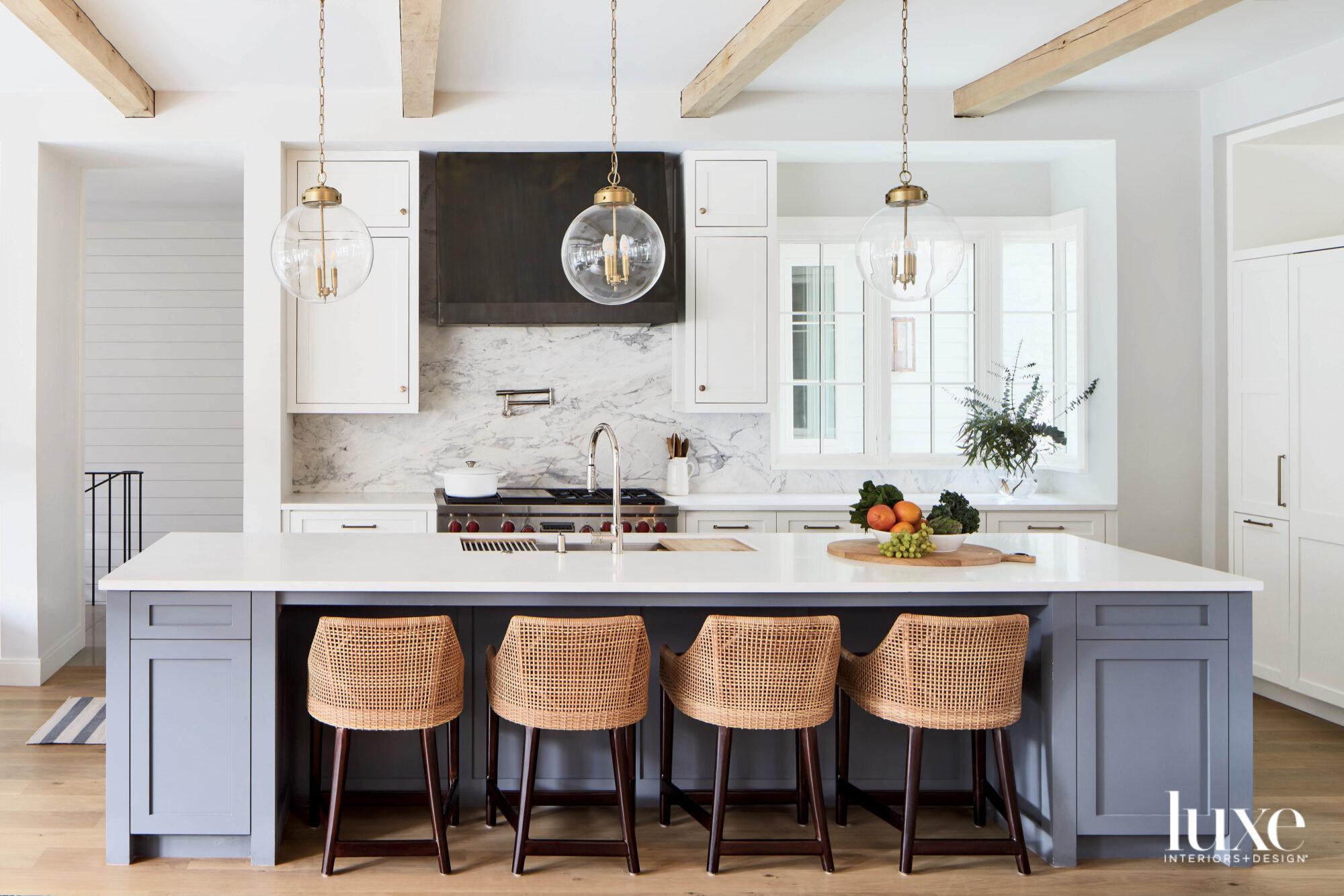 Kitchen with dark blue island...