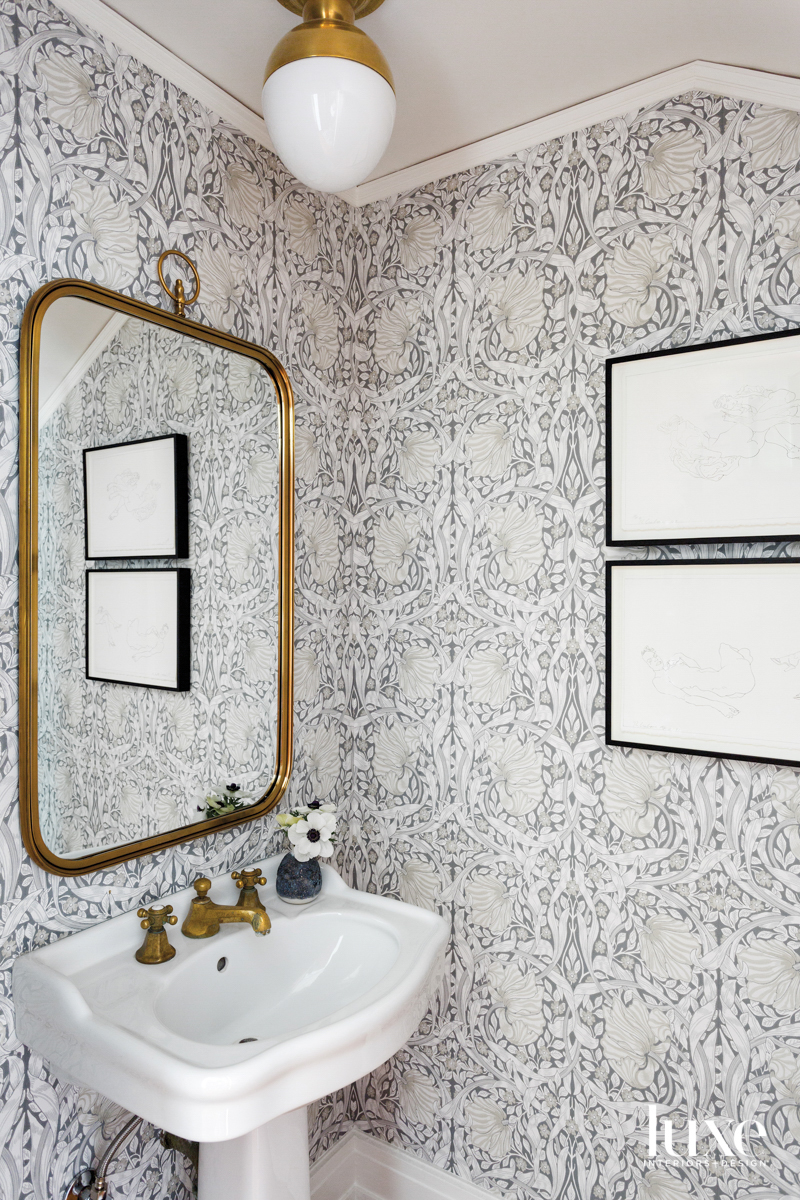 Small powder room with wallpaper...