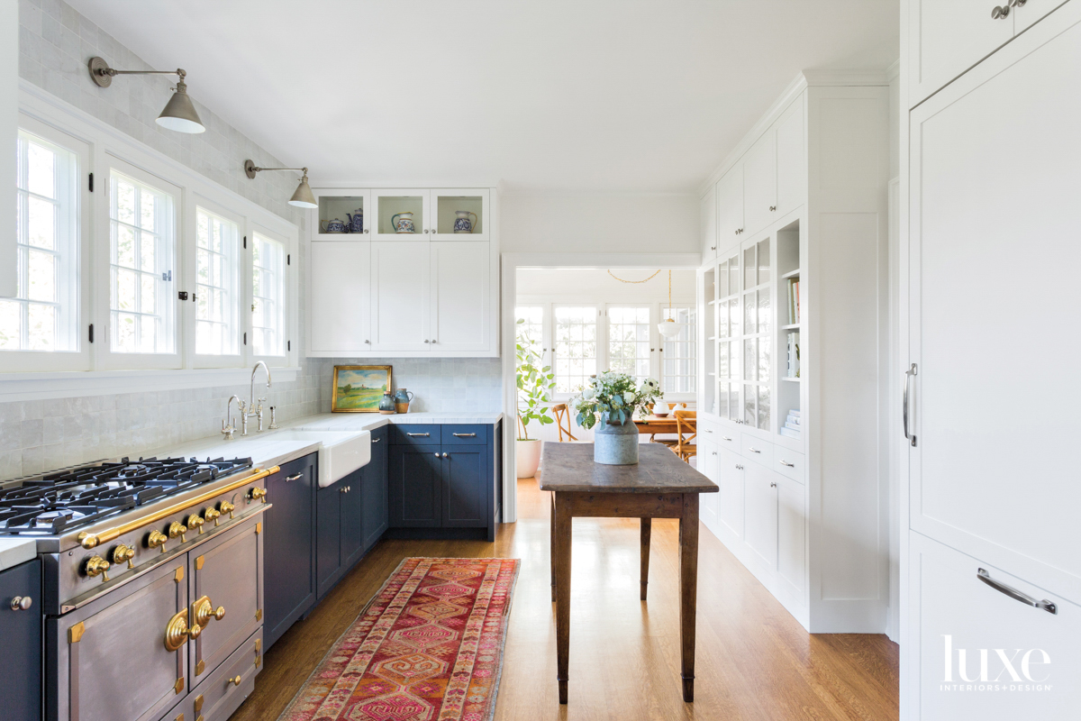 Kitchen with blue painted cabinetry...