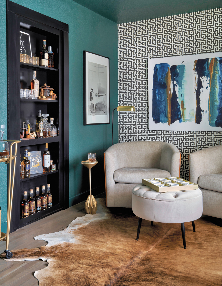 sitting area with teal wall and black and white wallpaper