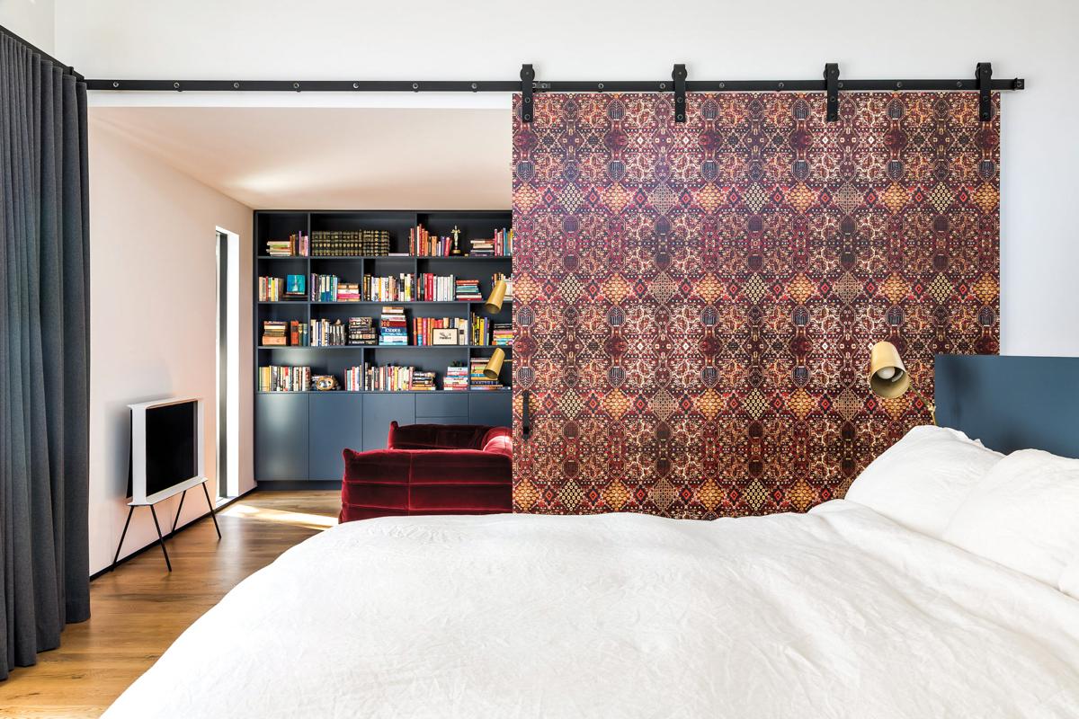 bedroom with sitting area hidden by sliding door