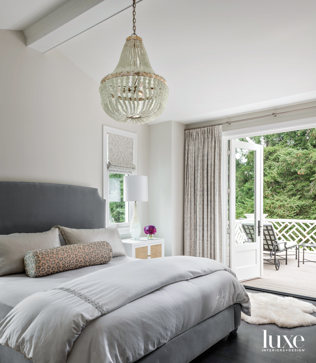 Main bedroom with upholstered bed,...