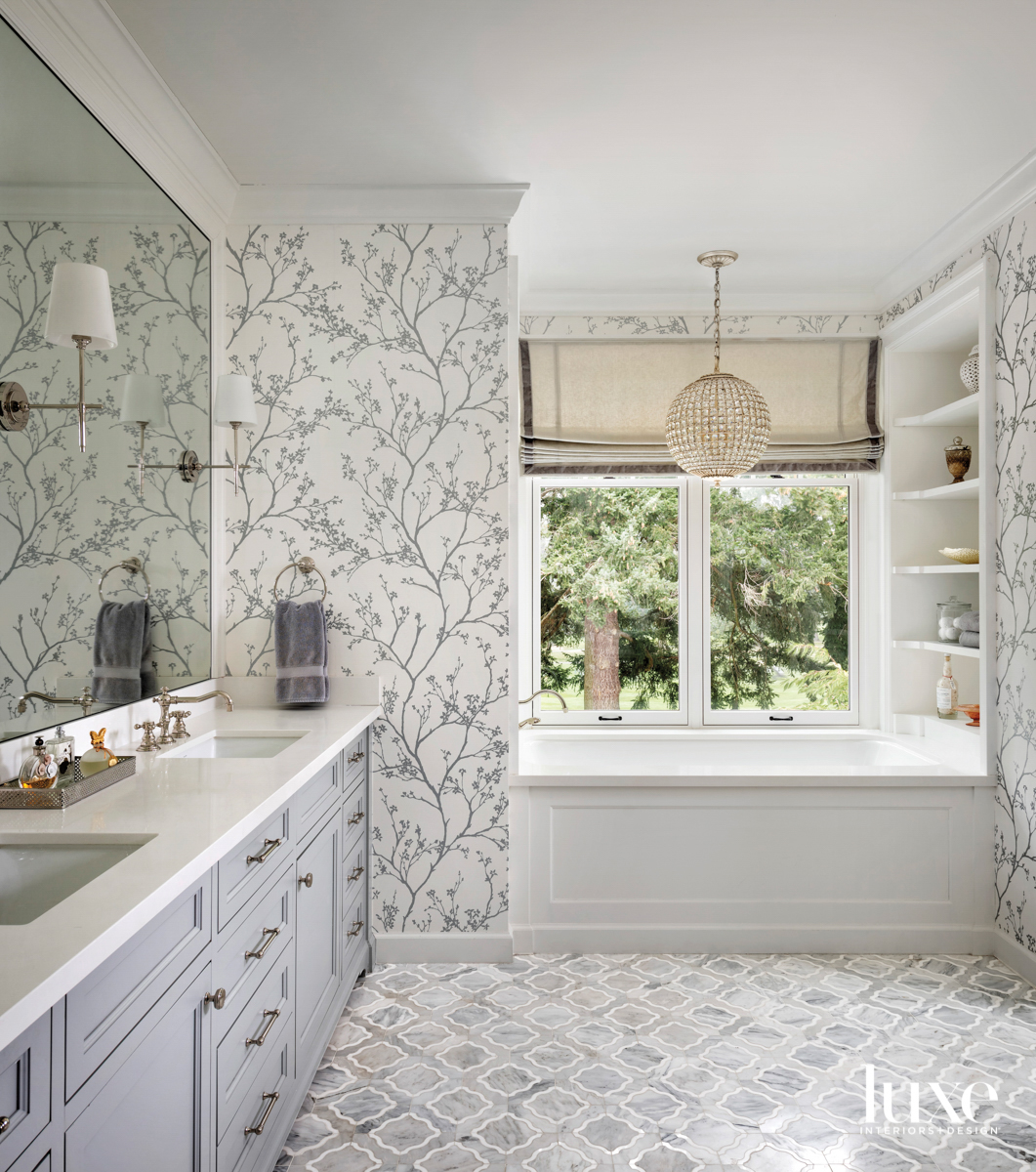 Main bathroom with floral wallpaper...