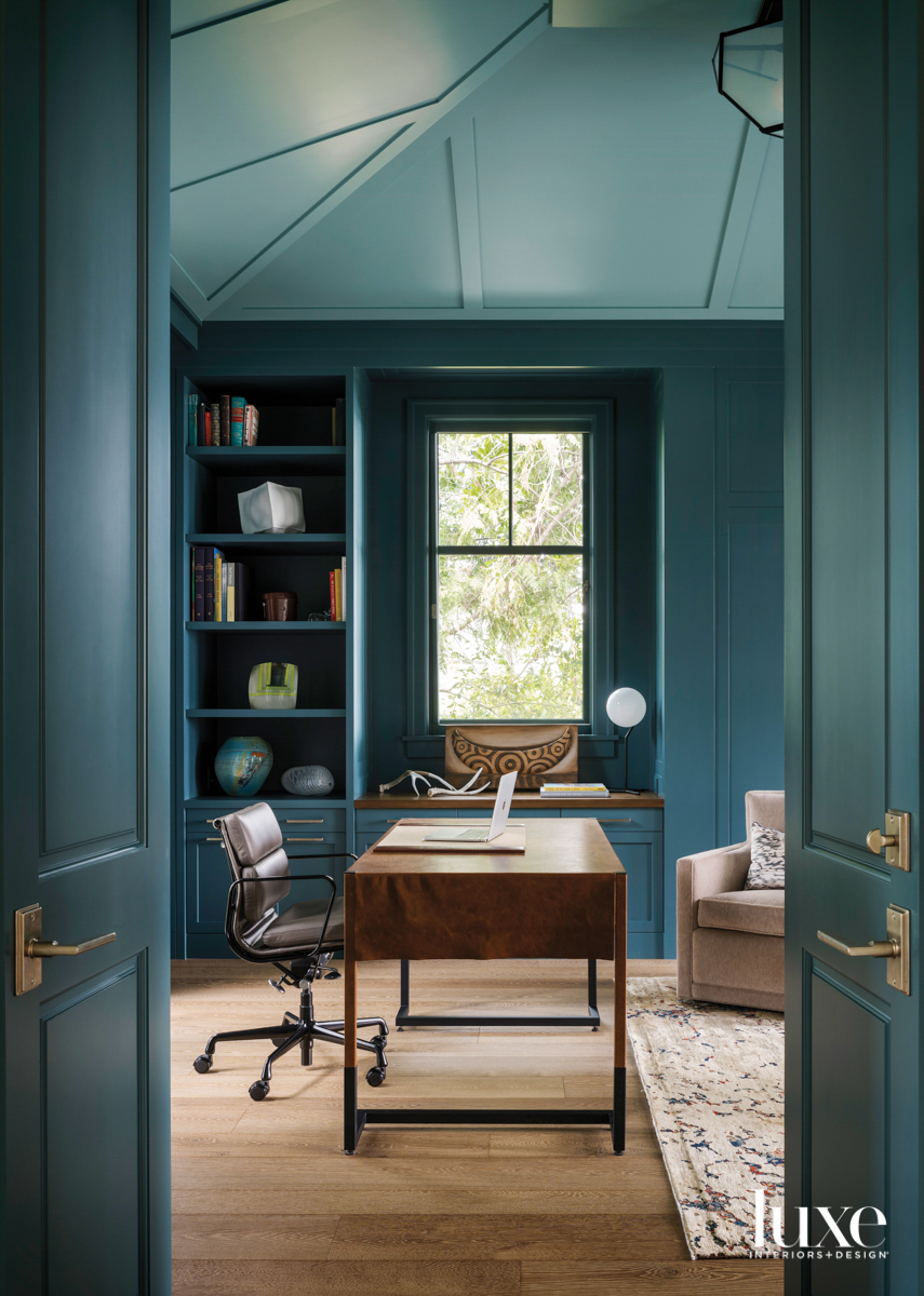 Wood paneled office painted teal