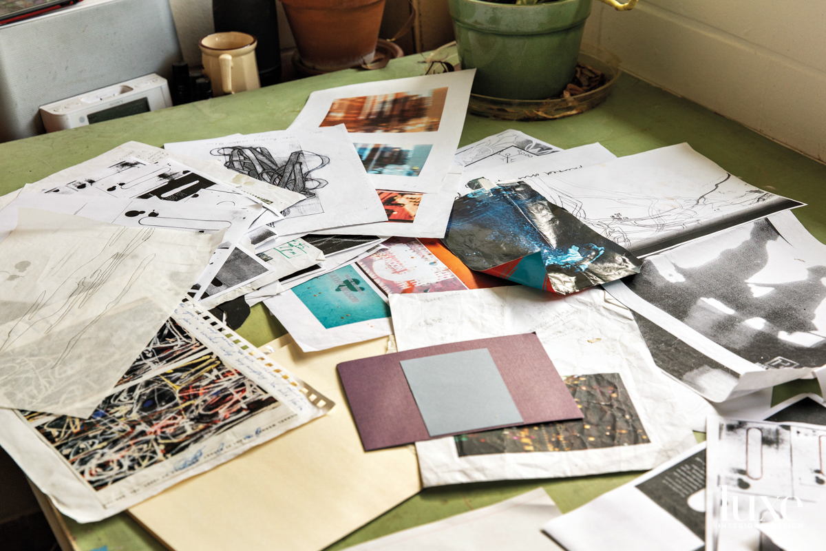 Photos and drawings on a table