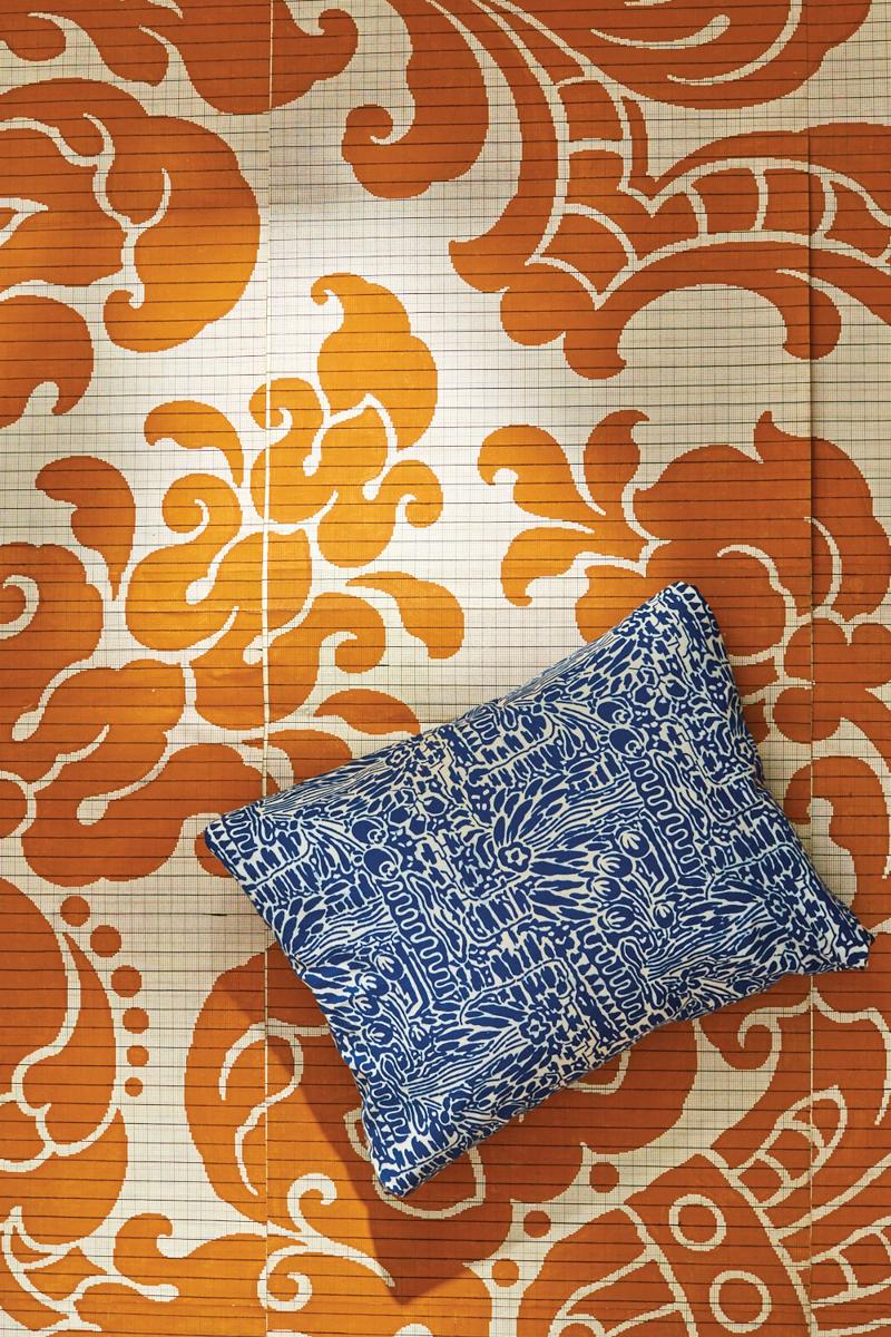 orange tile with blue pillow
