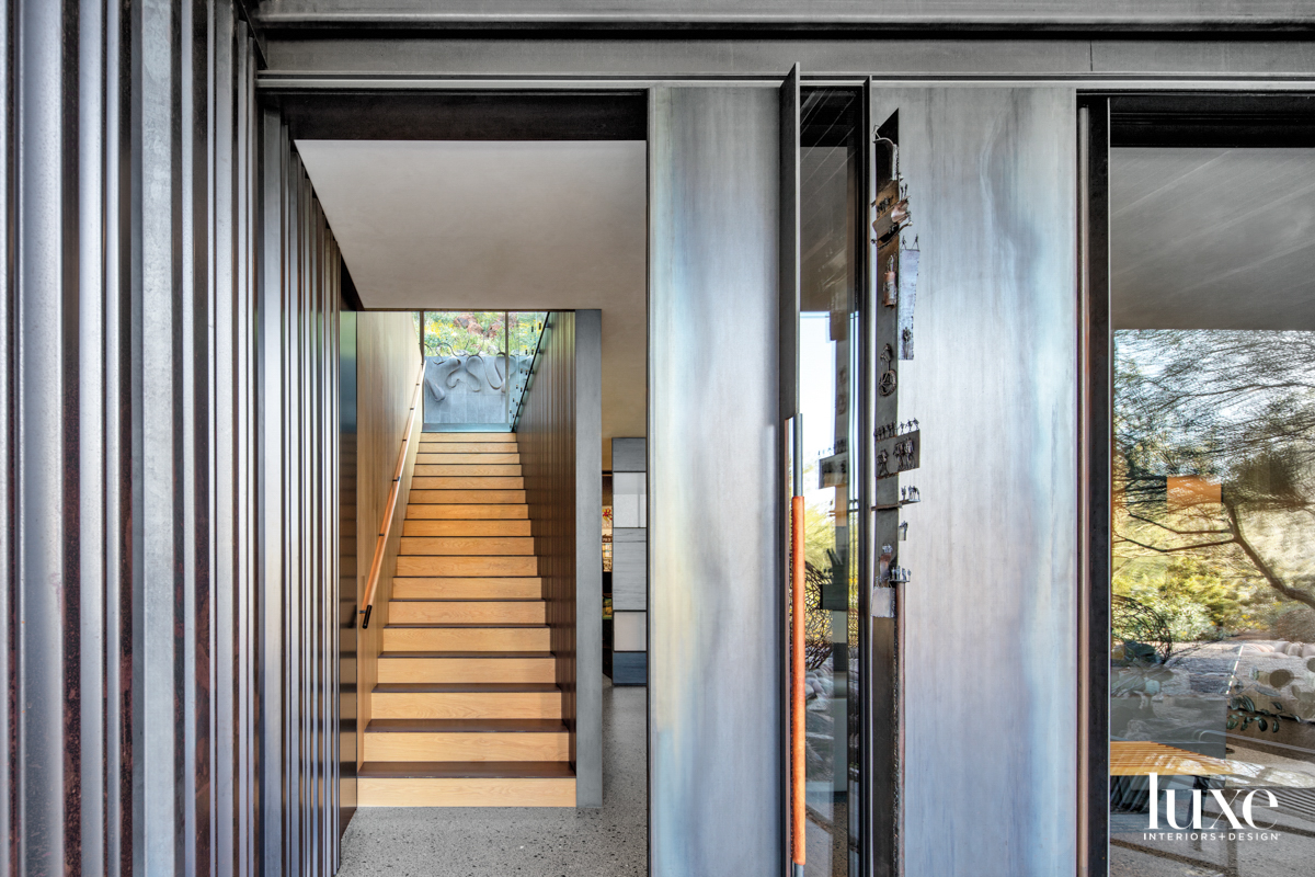An entryway with terrazzo floors...