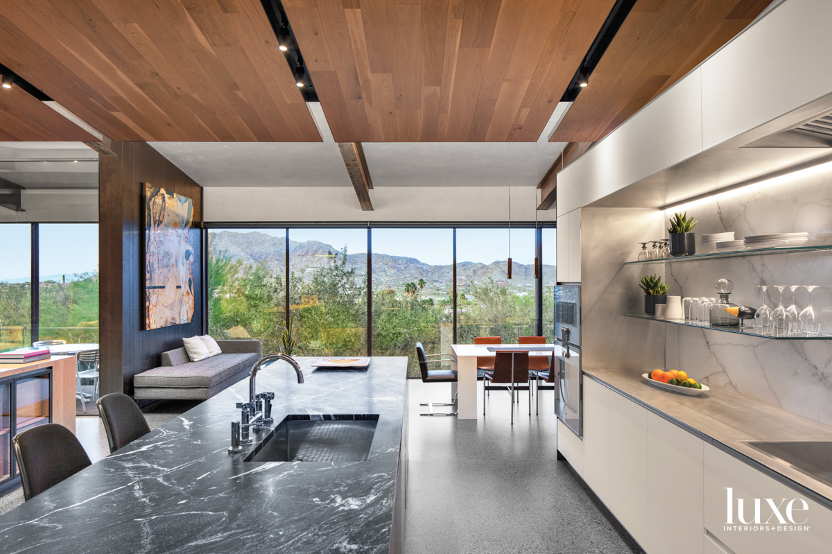 A minimalist kitchen with a...