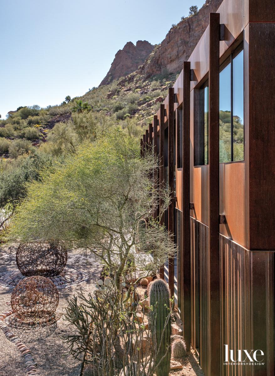 Desert landscaping outside the house.