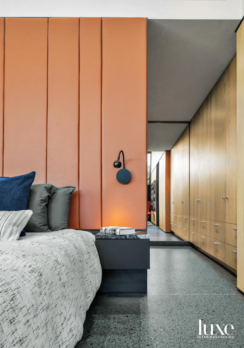 A bedroom with terrazzo floors...