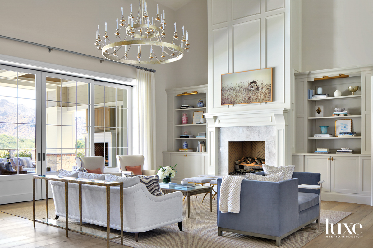 A white living room with...