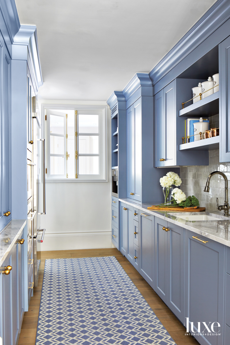 A pantry with blue cupboards.