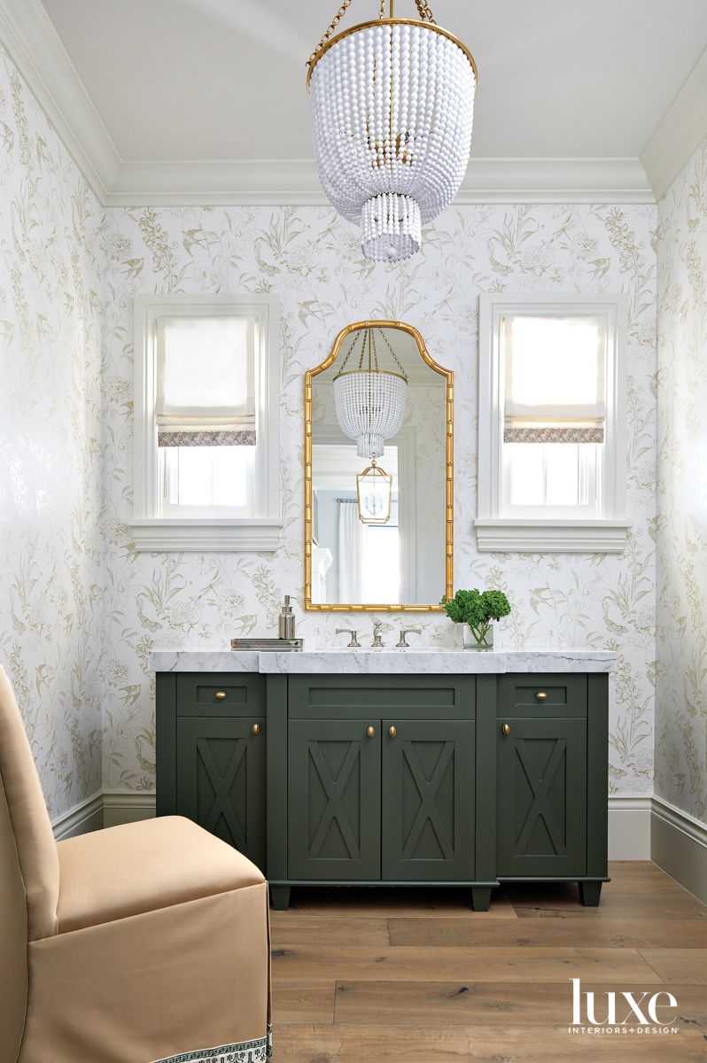 A bathroom with floral white-and-gold...