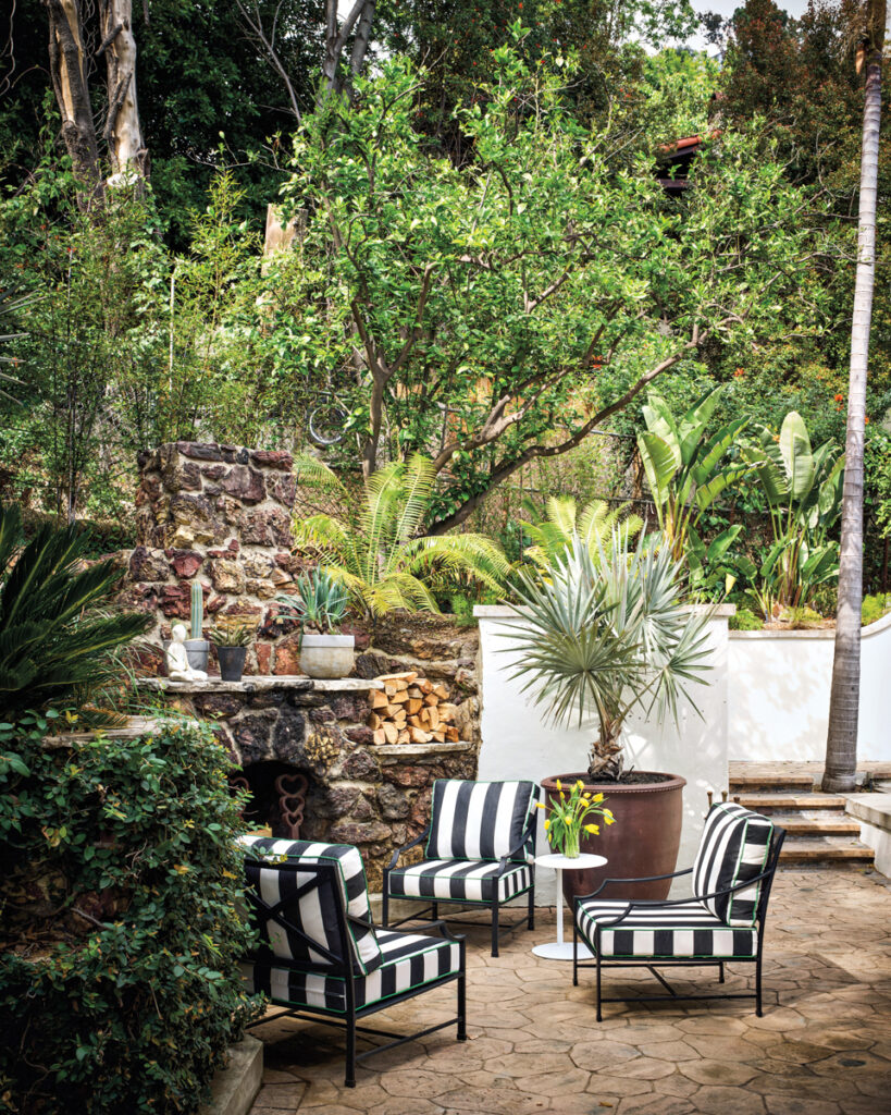 striped chairs outdoor fireplace