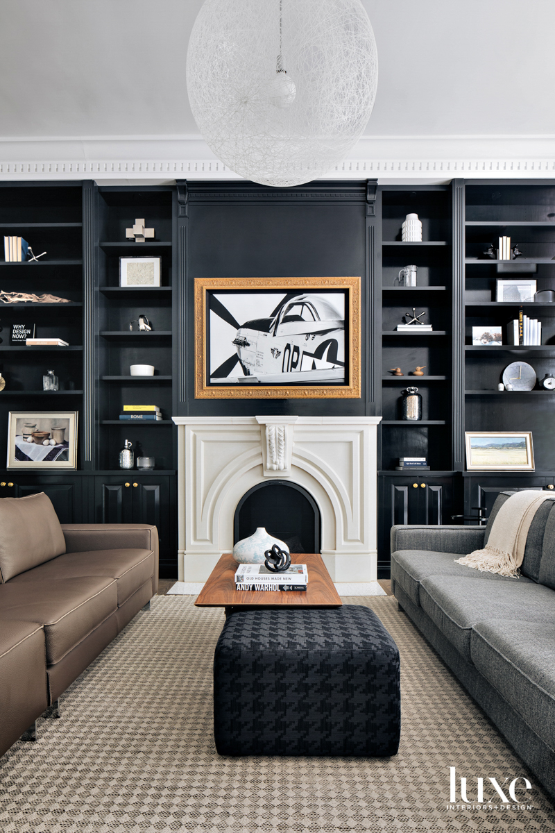 A living room with black...