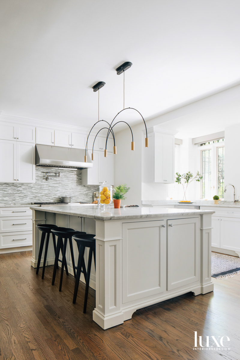 A white kitchen with marble...