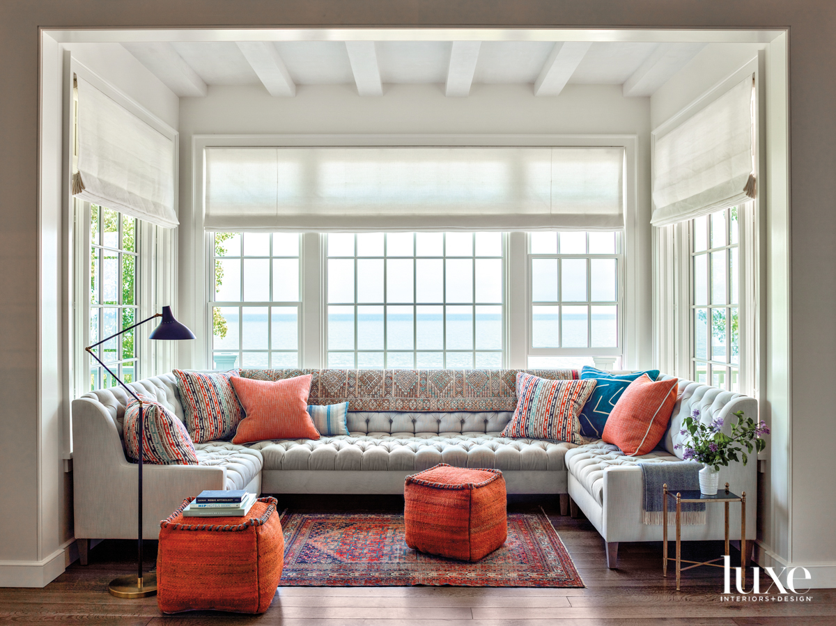 A sectional in a window area that overlooks Lake Michigan.