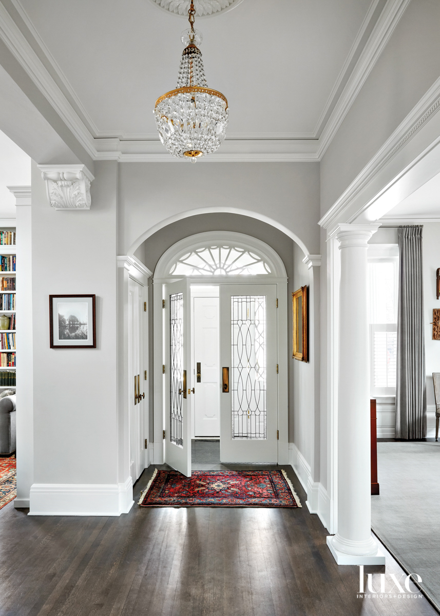 An entryway with a chandelier...
