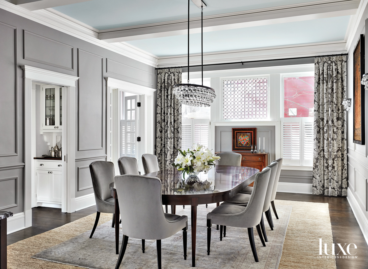 A gray dining room with...