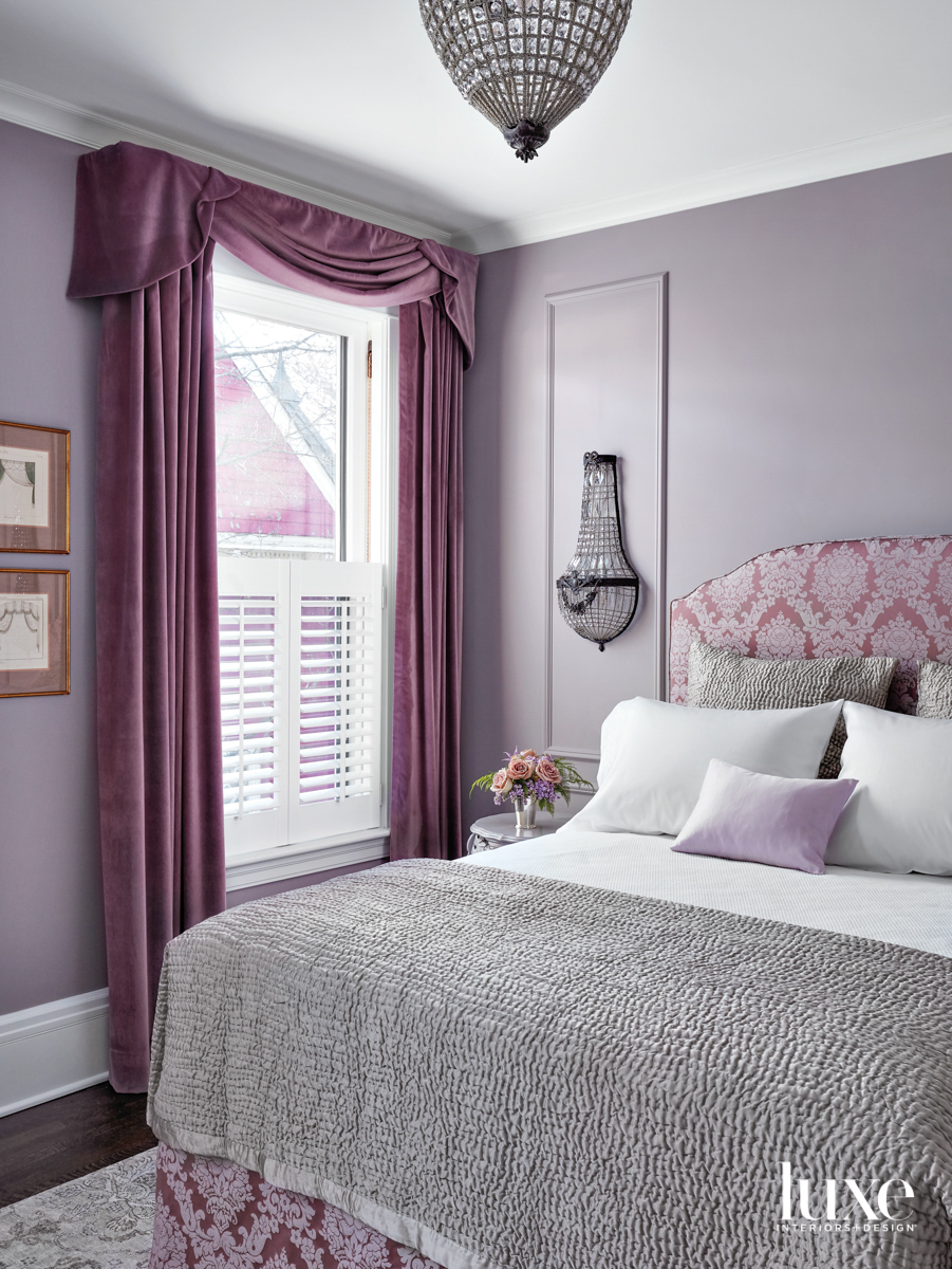 A lavendar bedroom with purple...