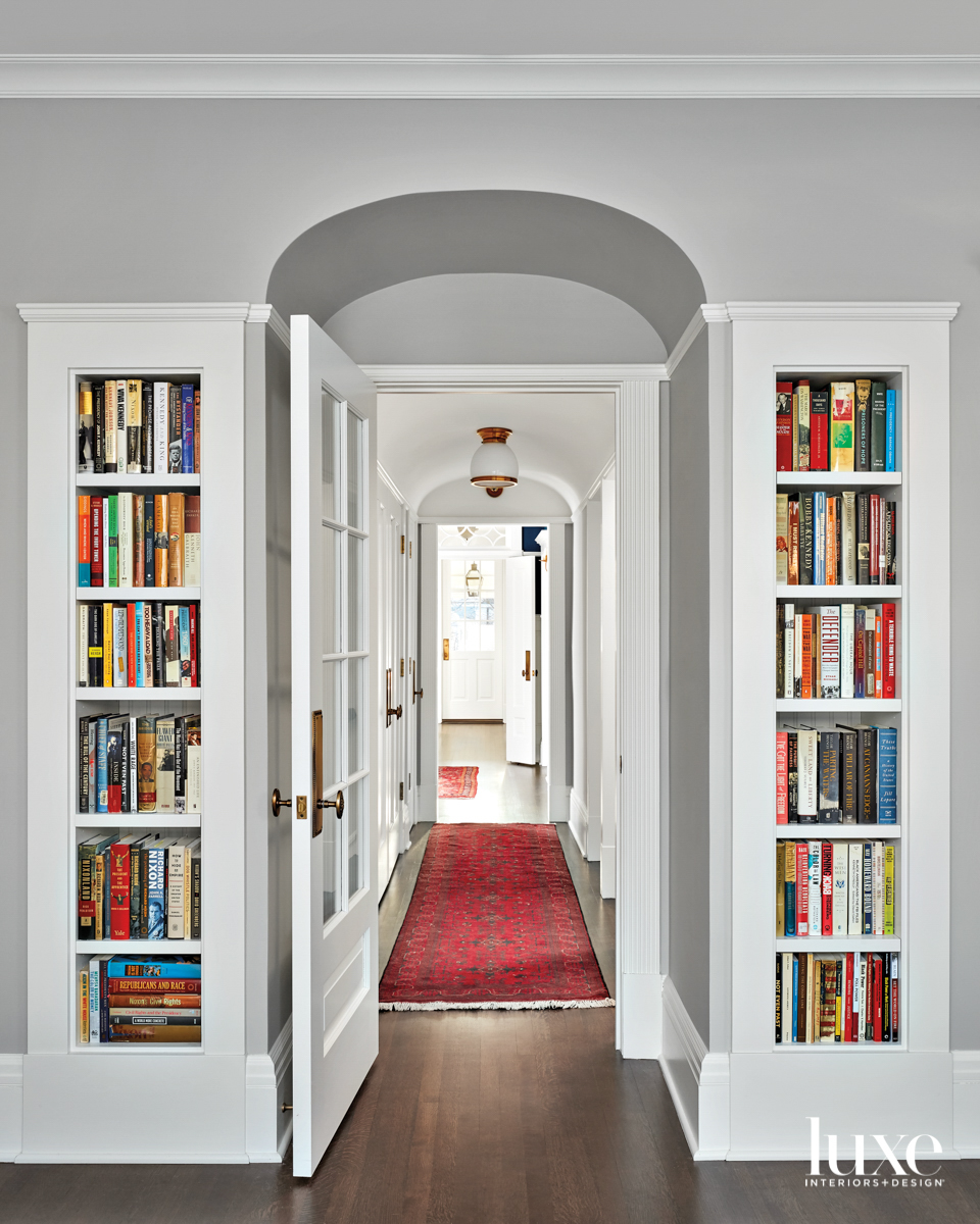 A hallway entrance with bookshelves...