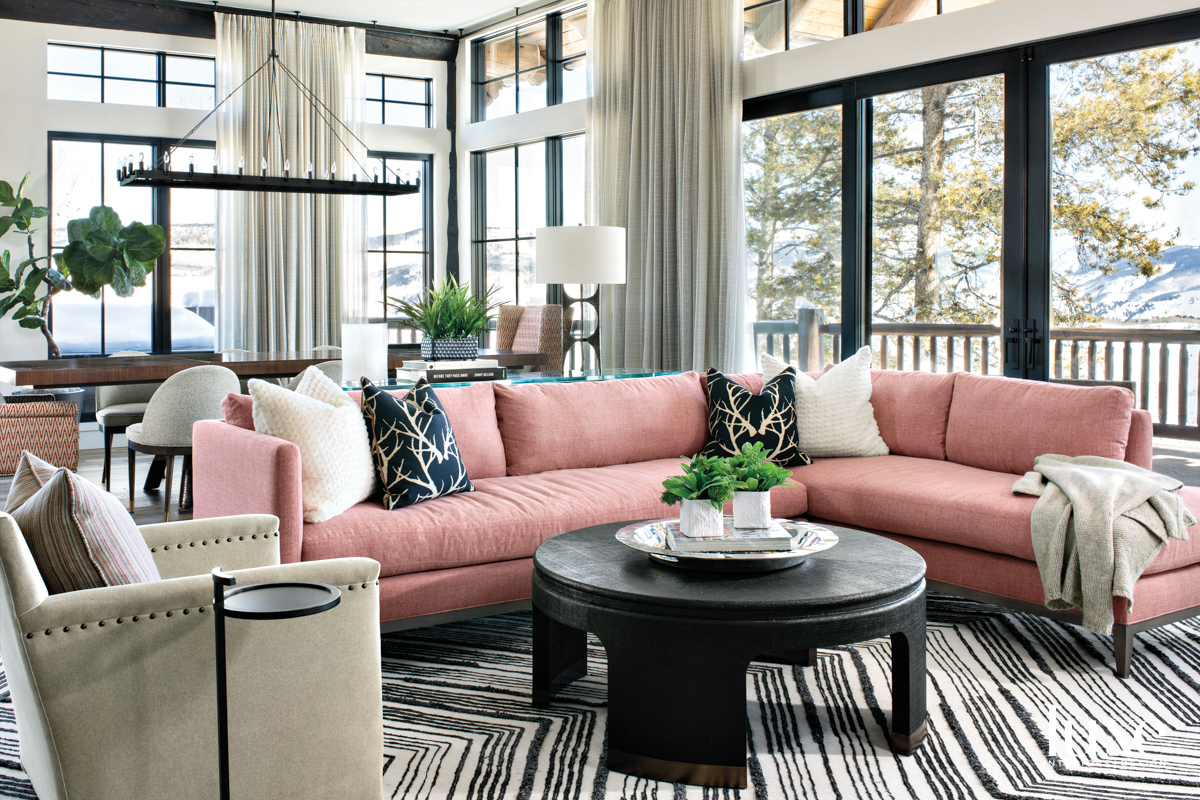 A blush-colored sectional provides comfortable...