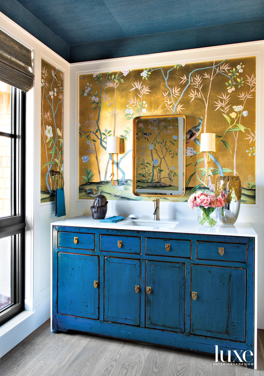 bathroom with blue sideboard and...