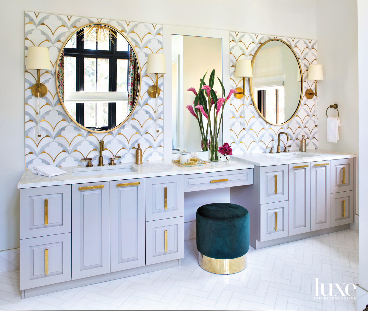 glam primary bathroom with brass...