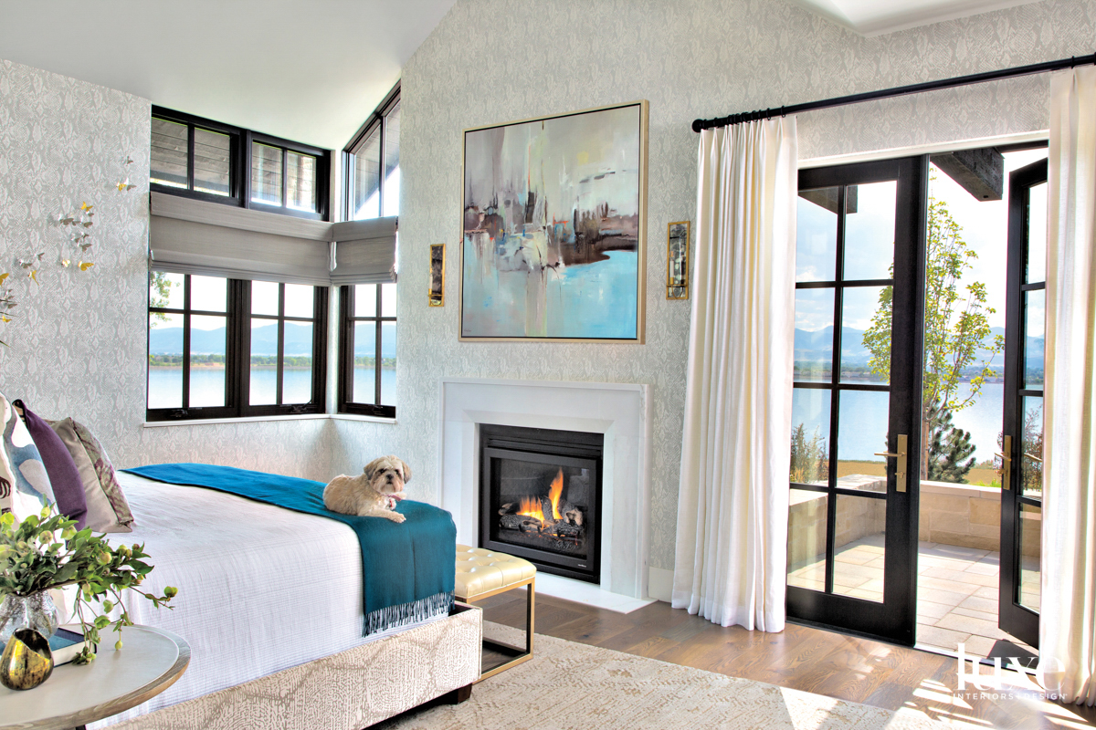primary bedroom with fireplace and...