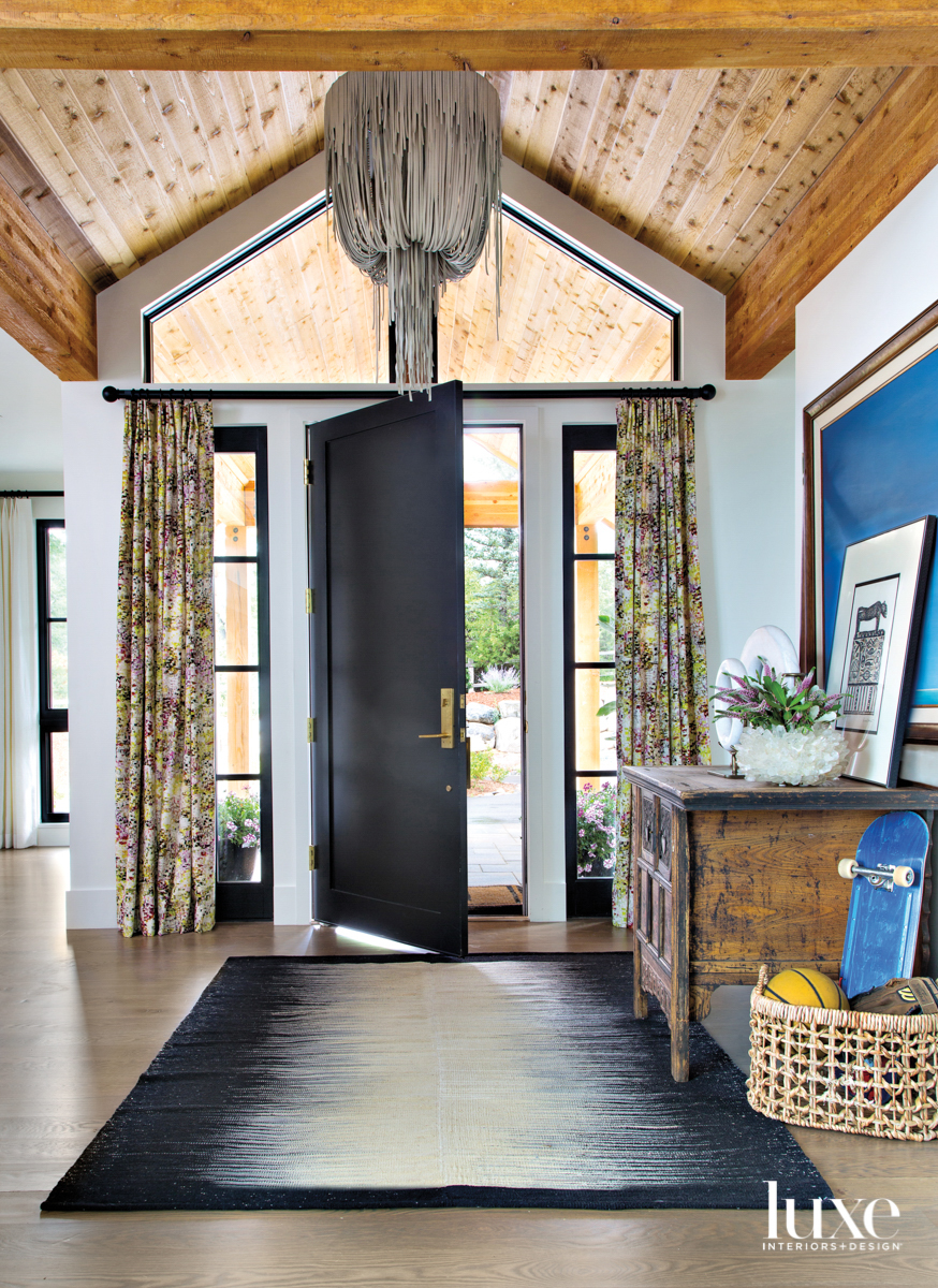 rustic entry with antique chest...