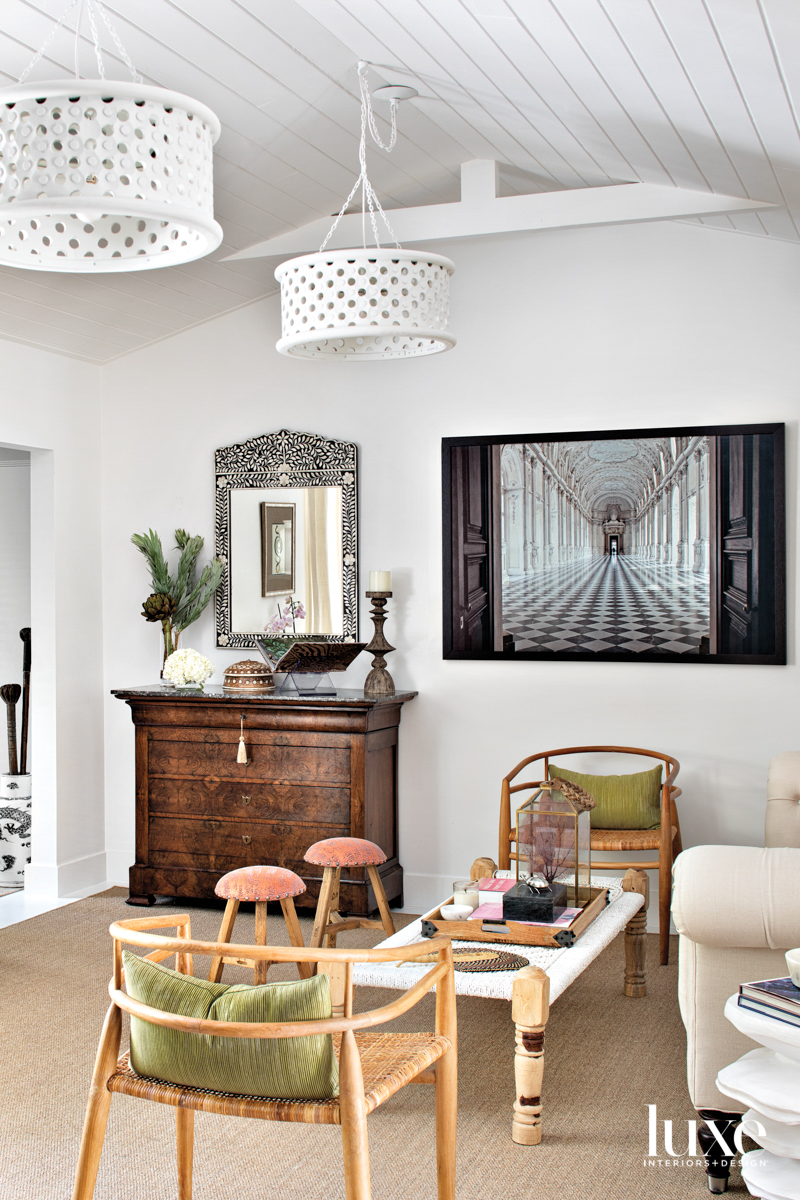 family room with wood-framed chairs,...