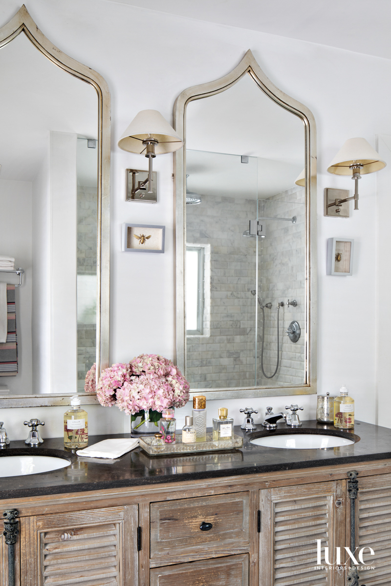 white primary bathroom with black-topped...