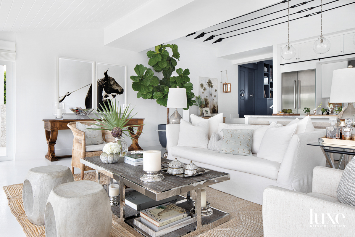 living area with white sofa,...