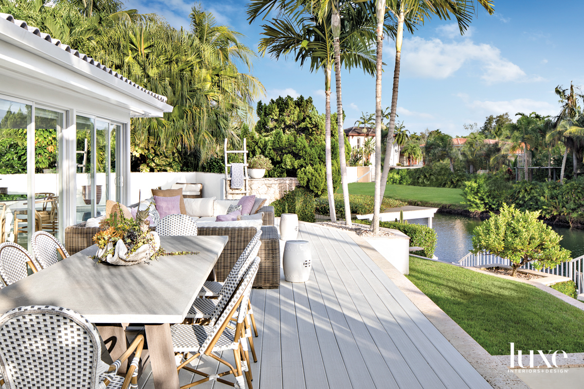 back patio overlooking waterway with...
