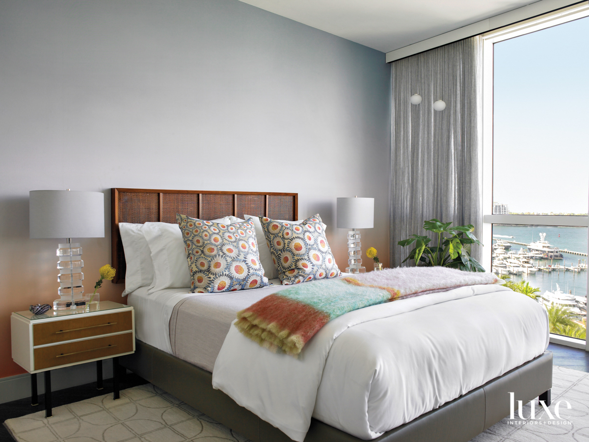 guest bedroom with rattan headboard,...