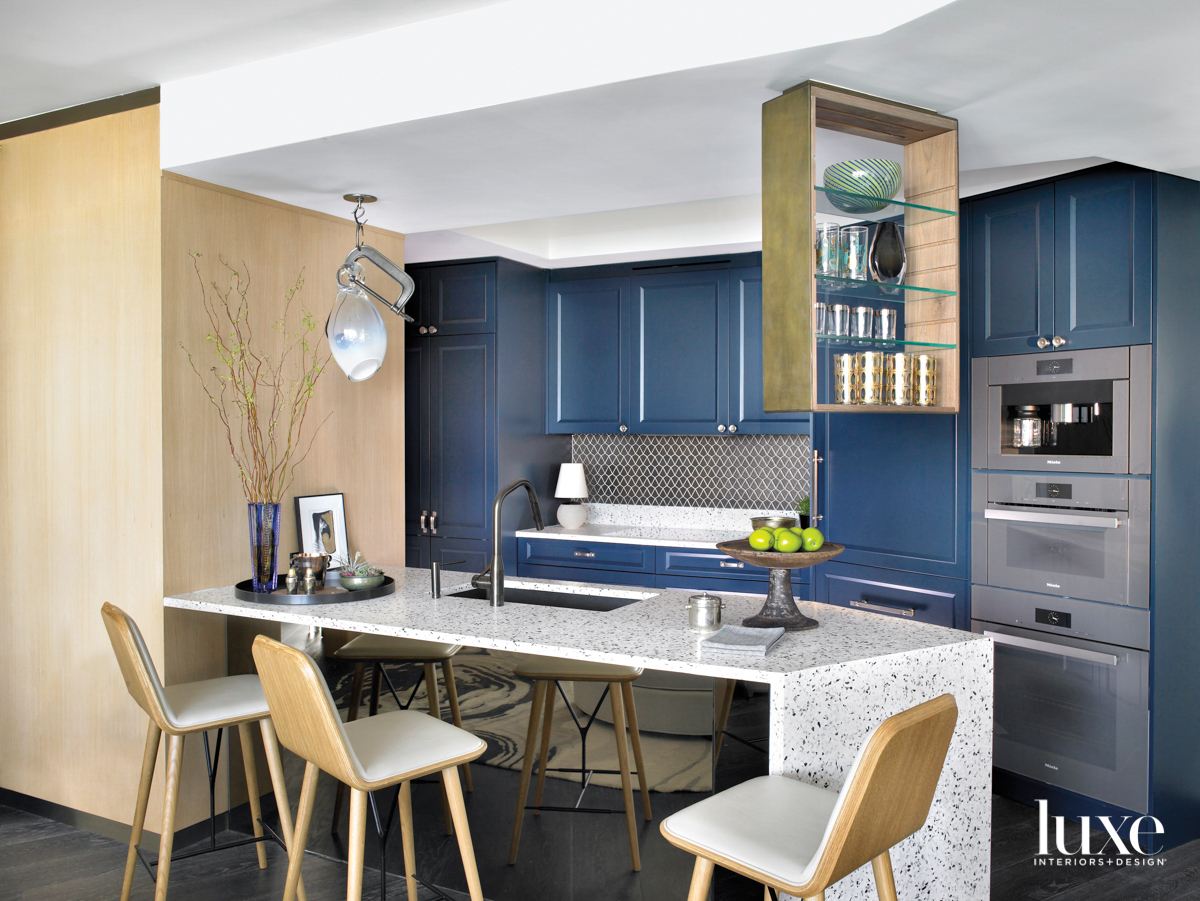 kitchen with blue cabinetry, wood...