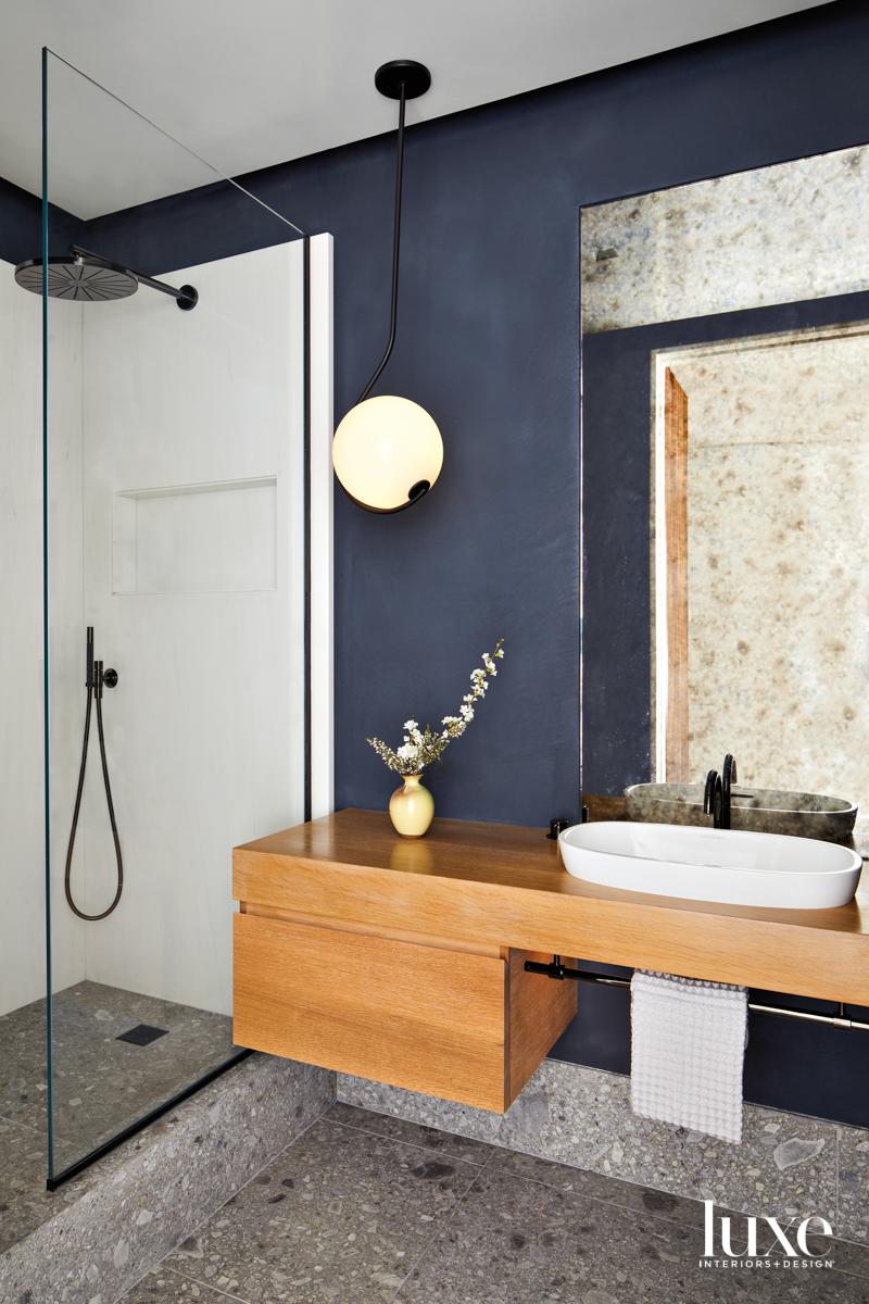 blue plaster bathroom with antique...