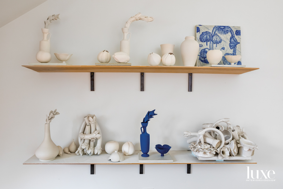white and blue ceramic sculptures on shelf