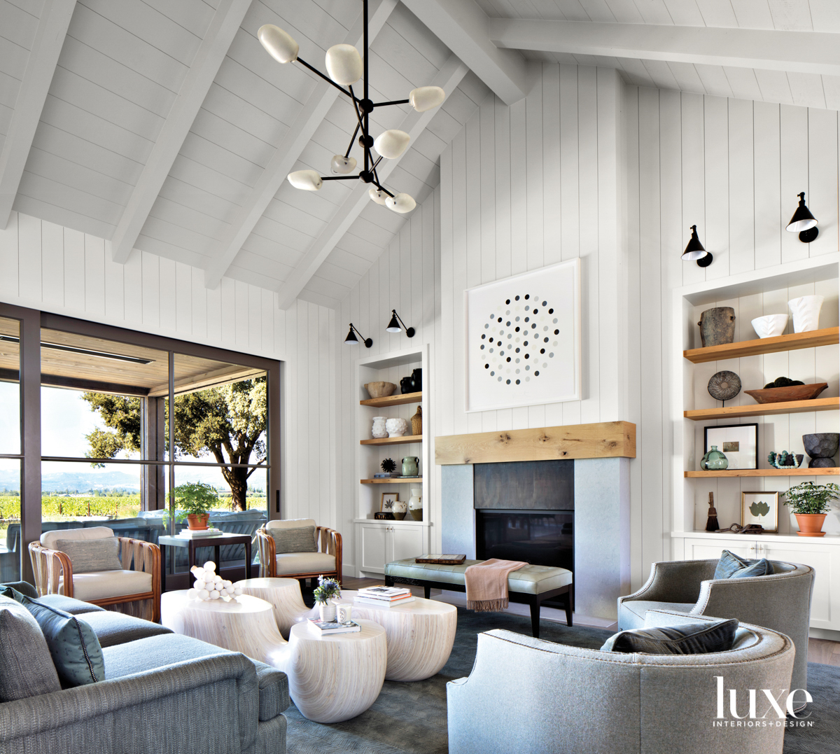 vaulted ceiling white paneled living...