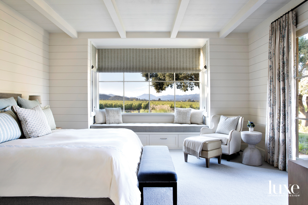 A bedroom features a large...