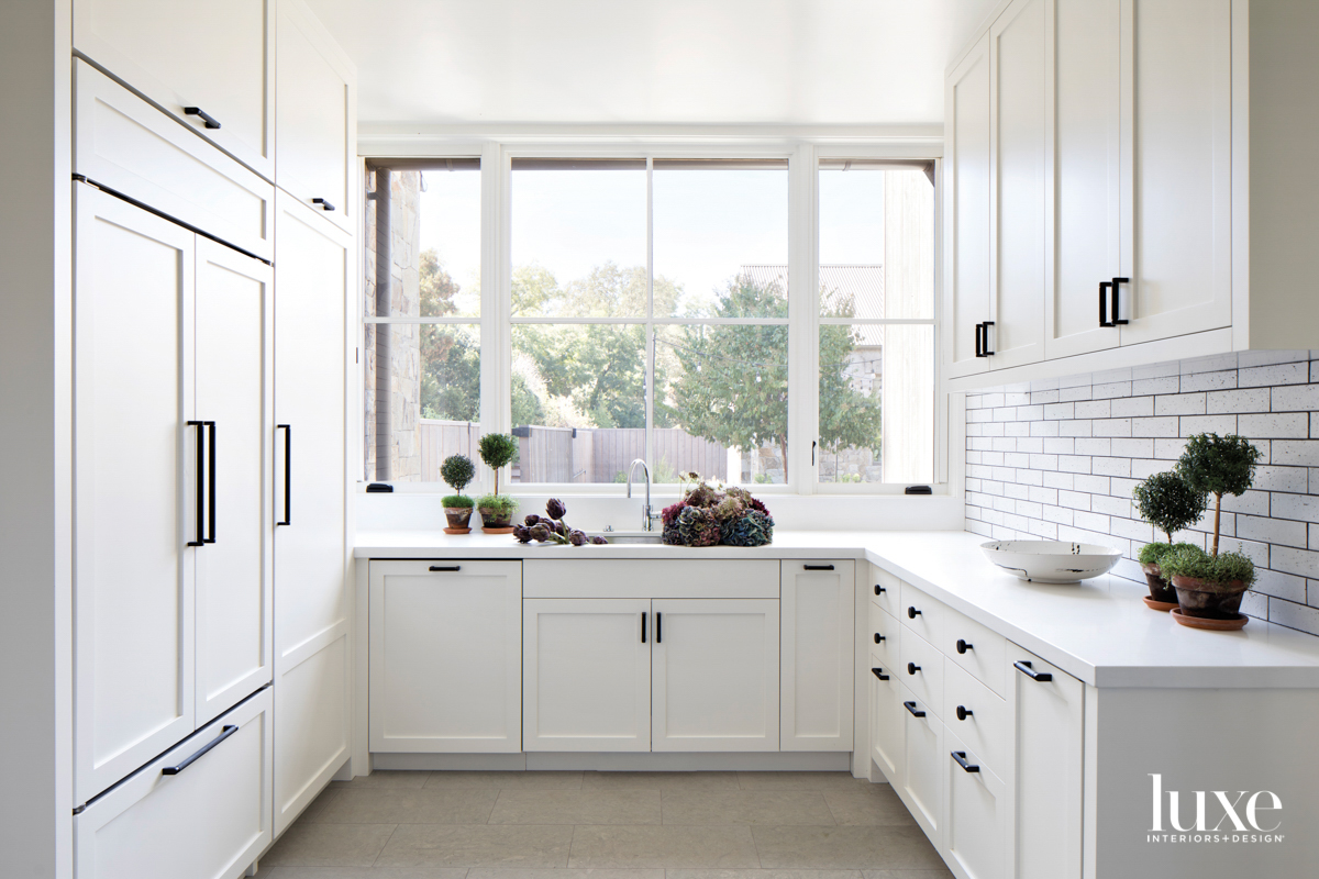 white pantry with laundry room...