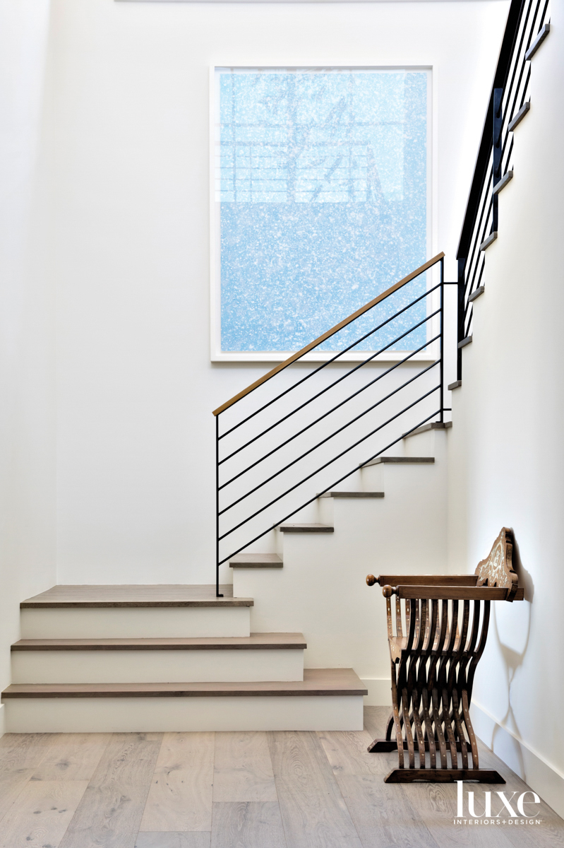transitional staircase with iron railing