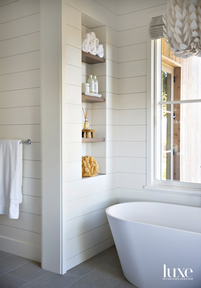 white bathroom with soaking tub...
