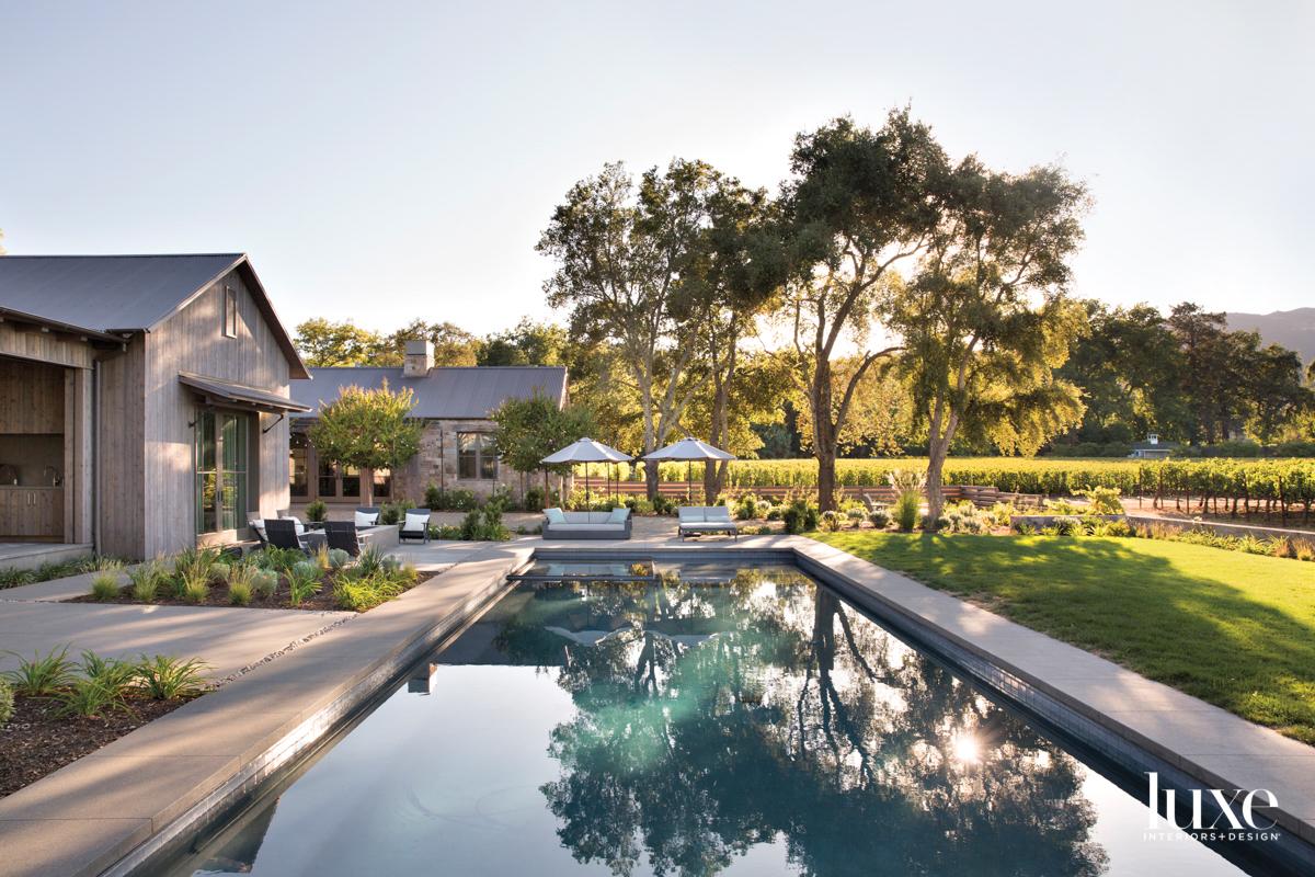 backyard with long pool and...