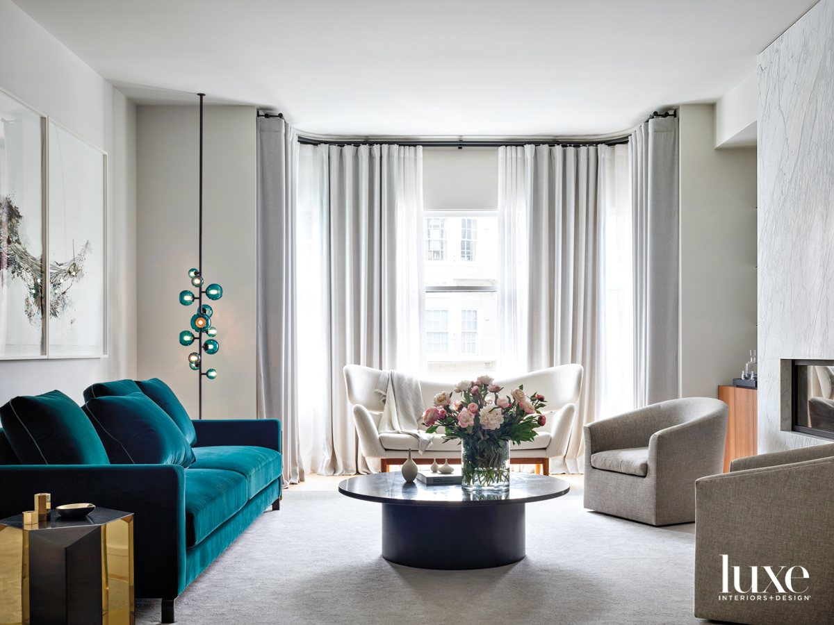 neutral living room with teal...