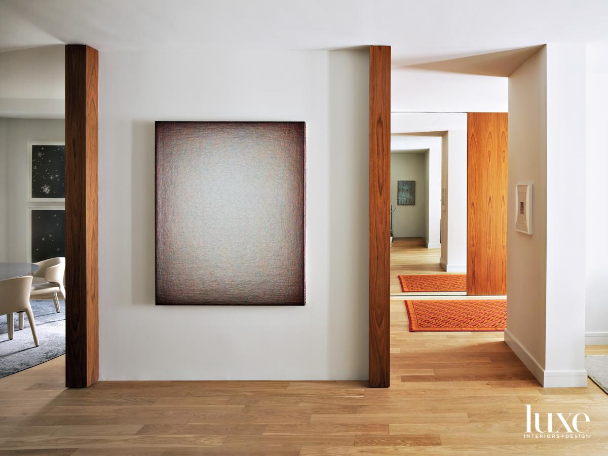 gray artwork in entry