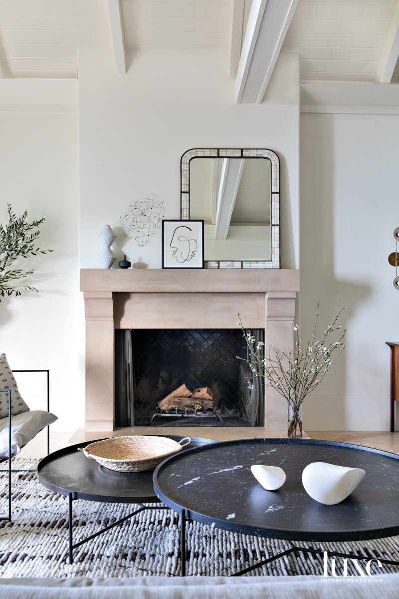 A stone fireplace mantel is...